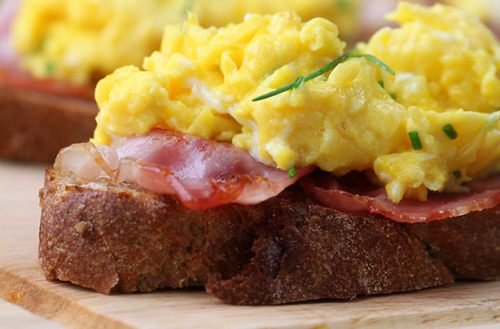 scrambled eggs  bacon on toast